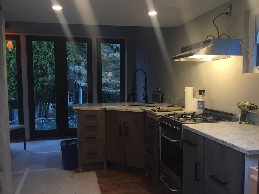 Tiny House kitchen and living space built with as many reused and repurposed building materials as possible.